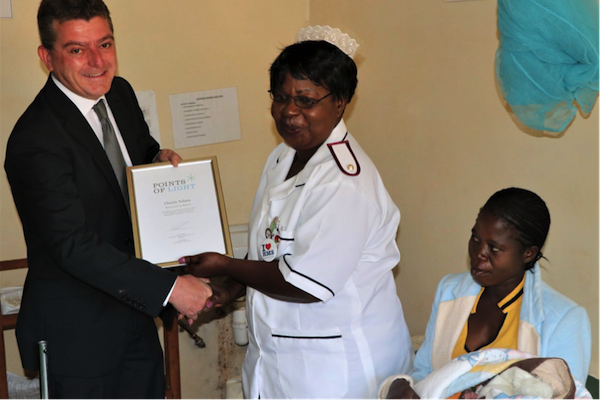Charity Salima receiving her Points of Light award